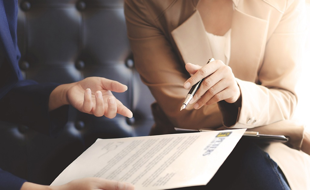 A lawyer discusses a letter with a client